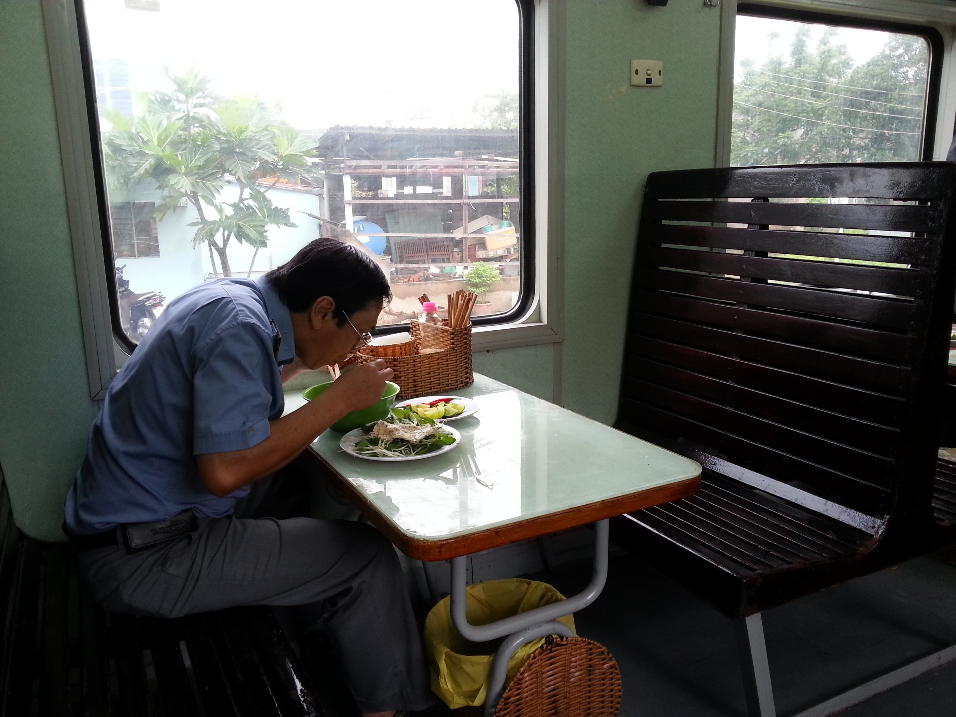 Diner enjoying his noodles on a Vietnam train