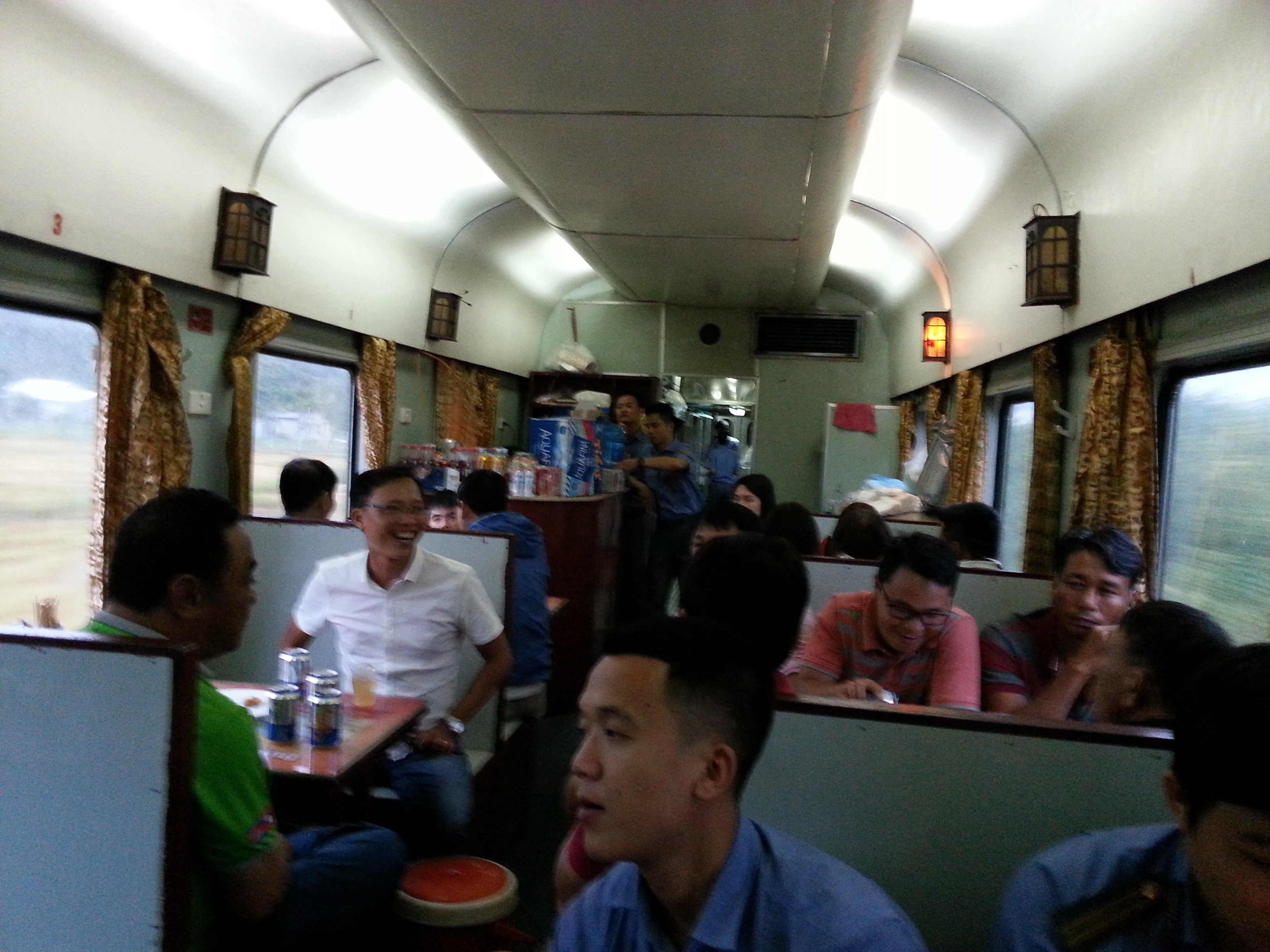 In Vietnam men drink beer on the train